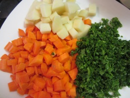 Chop carrots, potatoes and parsley.