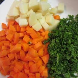Chop carrots, potatoes and parsley.